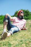 Young man laying on grass — Stock Photo
