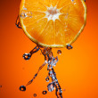 Orange with water — Stock Photo