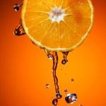 Orange with water — Stock Photo
