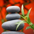 Massage stones with bamboo - Stockfoto