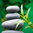 Massage stones with bamboo - Stock Photo
