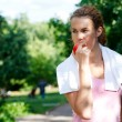 Young woman after sport workout eating apple — Stock Photo