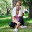 Woman sitting on grass — Stock Photo