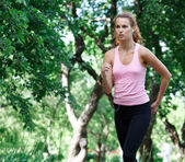 Woman running in the park. — Stock Photo
