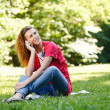 Woman talking over the phone in park — Stock Photo