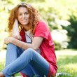 Woman sitting on grass in park — Stock Photo #5872697