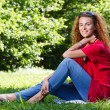 Woman sitting on grass in park — Stock Photo #5873015