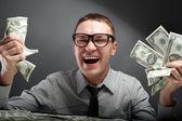 Gelukkig man met geld — Stockfoto