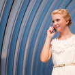 Beautiful woman talking over a phone — Stock Photo