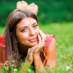 Beautiful woman lying on a grass — Stock Photo #6128542