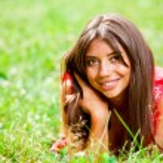Beautiful woman lying on a grass — Stock Photo #6128549