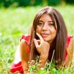 Beautiful woman lying on a grass — Stock Photo #6128553
