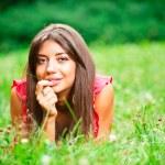 Beautiful woman lying on a grass — Stock Photo #6128560
