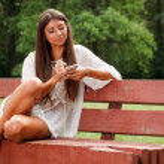 Beautiful woman reading small book — Stock Photo #6128563