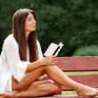 Beautiful woman reading small book — Stock Photo
