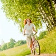 Young woman riding at bicycle — Stock Photo
