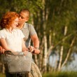 Young couple sitting at one bicycle — Stock Photo