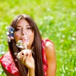 Beautiful woman blowing soap bubbles — Stock Photo #6315139