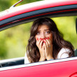 Young pretty woman in the red car — Foto Stock