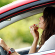 Woman doing makeup while driving — Stock Photo