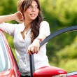 Stock Photo: Young pretty woman in the red car
