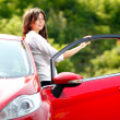 Young pretty woman in the red car — Stock Photo #6315261