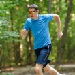Stock Photo: Young jogger runnig at the park