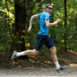 Young jogger runnig at the park — Foto Stock