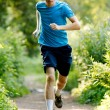 Young jogger runnig at the park — Stock Photo