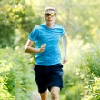 Young jogger runnig at the park — Stock Photo #6315398