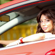 Young pretty woman in the red car — Foto de Stock