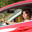 Young pretty woman in the red car — Stock Photo #6315665
