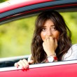 Young pretty woman in the red car — Stock Photo #6315728