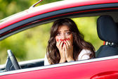 Young pretty woman in the red car — Stock Photo