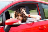 Młoda ładna kobieta w czerwony samochód — Zdjęcie stockowe