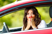 Young pretty scared woman in the car — Stock Photo