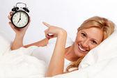Beautiful woman with clock — Stock Photo