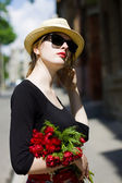 Woman with red lipstick in sunglasses and straw hat — Stock Photo