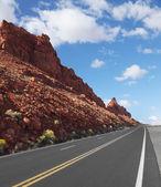 The road passes rocks of sandstone — Stock Photo