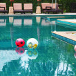 Three beautiful colored balls in the pool — Stock fotografie