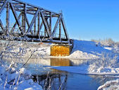 Old railway bridge through small river — Stock Photo