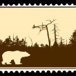 Vector silhouette bear on postage stamps — Image vectorielle
