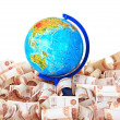 Globe against five thousandth Russian banknotes — Stock Photo