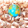 Stock Photo: Globe against five thousandth Russibanknotes
