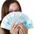Thoughtful Girl with a Fan thousands of denominations. — Stock Photo