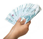 Stack of one thousandth bills in the female hand. — Stock Photo