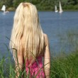 Long-haired blonde is waiting on the shore. — Stock Photo #6470255