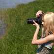 Girl photographer on the nature. — Stock Photo #6470429