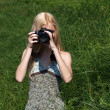 Girl photographer on the nature. — Stock Photo #6470435