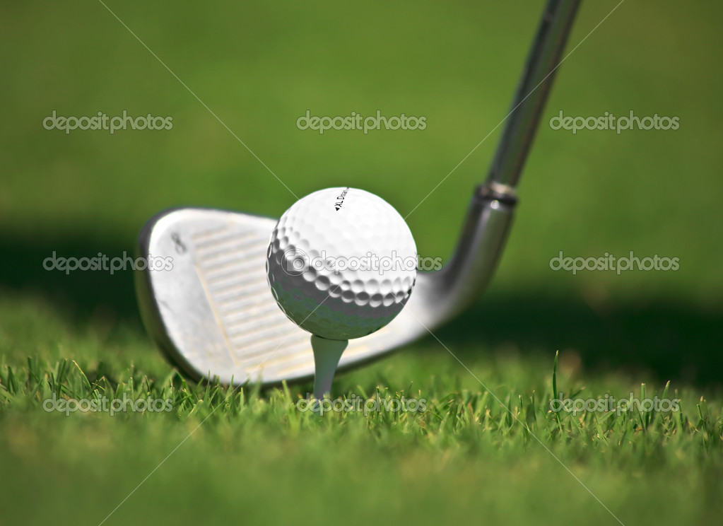 Golf ball and iron against the grass.  Stock Photo #6682997
